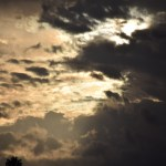 Morning Sun rising behind clouds12