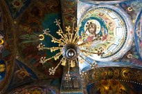 A chandelier, skylight and colorful mosaics at The Church of the Savior on Spilled Blood in St. Petersburg, Russia.