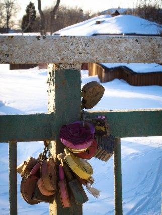 Locks of love on a bridge in Suzdal