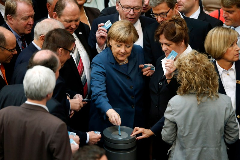 German Chancellor Angela Merkel casts her vote during meeting of parliament.