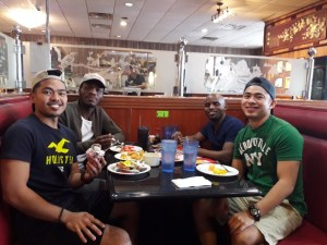 Bongani and Lindelihle dining out with their Filipino fellow interns, housemates