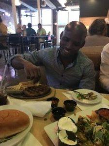 Bongani, enjoying his first American steak!