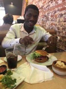 Lindelihle enjoying his first doubledecker hamburger