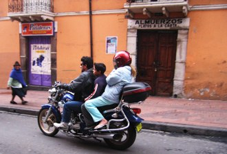 Three Up Quito Biker