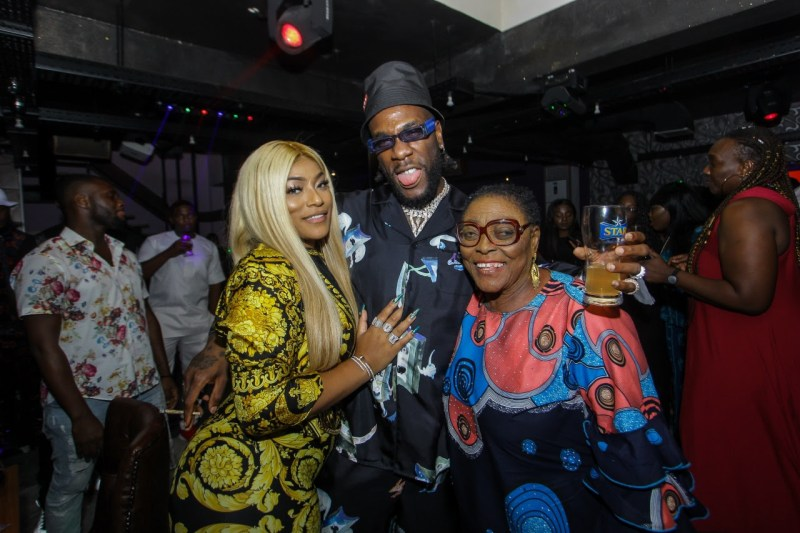 "It was a night of glitz and glam as the ""African Giant"" Burna Boy celebrated his 28th birthday with family and friends at a private birthday dinner last night. The event was attended by his Grandparents, mother, his girl Stefflon Don, executives from Star (Nigerian Breweries), and industry friends like Dbanj, Korede Bello, Phyno, Kaffy, Olisa, Zlatan, DJ Lambo, Peedipicasso , Kaffy, Poco Lee, Toolz O, Slim case, VJ Adams, Moet, Jimmie, Efe Omoregbe, and Chopstix. The highlight of the evening was Burna Boy's grandparents cutting his birthday cake with him, as they prayed for the artiste and blessed him. His grandfather declared Burna's next award will be a grammy, and the guests responded with a resounding ""Amen!"". The birthday dinner also served to celebrate Burna Boy's victory at the 2019 BET Awards, where he bagged the award for Best International Act 2019. A special BET award celebration will be held later tonight at Quilox nightclub for the African Giant. Find moments f"