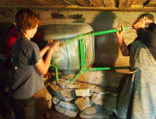 Village life Romania. Storing potatoes under the house for fierce Romanian winters.