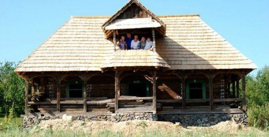 Duncan Ridgely,Penny Ridgely and family, authors of family travel book, Somewhere Different, in one of the houses they built in Romania.
