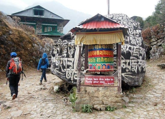Nepal with kids, trekking with kids. Cultural enlightenment near Everest. Prayer wheels and learning about religion and spirituality with the Sherpa people