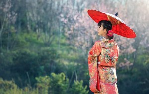 Asian girl in red dress holding an umbrella