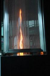 tall flame behind a black screen