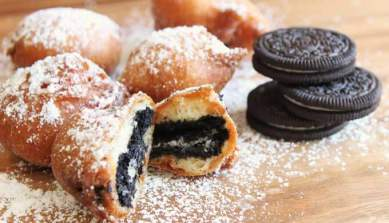 Oreos dipped in batter then deep fried sprinkled with icing sugar