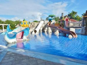 water slides leading to a pool