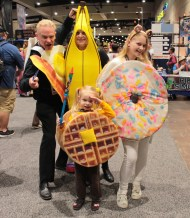 Family dressed as a banana, donut, waffle and bacon and eggs