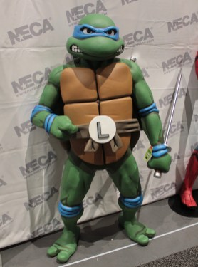 Teenage Mutant Ninja turtle Leonardo statue. He is wearing a blue eye mask