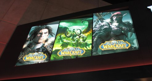 three part world of warcraft sign with a human, beast and undead pictured