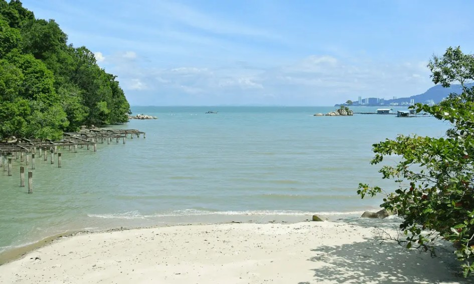 Depicts remote beach in Penang, Malaysia