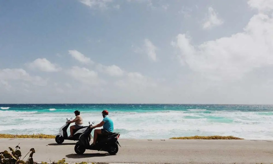 Top things to do Novalja - shows two people on mopeds - getting around