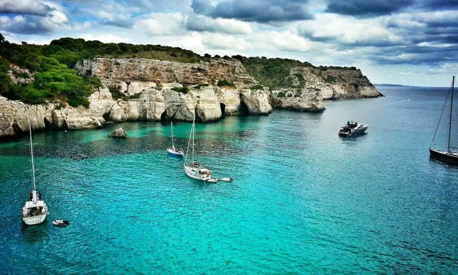 September beach holiday ideas - shows bay by the sea in Menorca