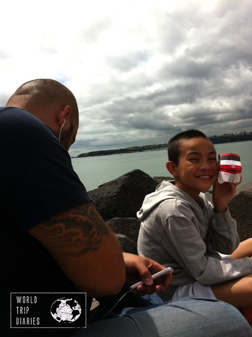 Meeting at the beach, Angelo on the headphones and Jose playing with a paper boat