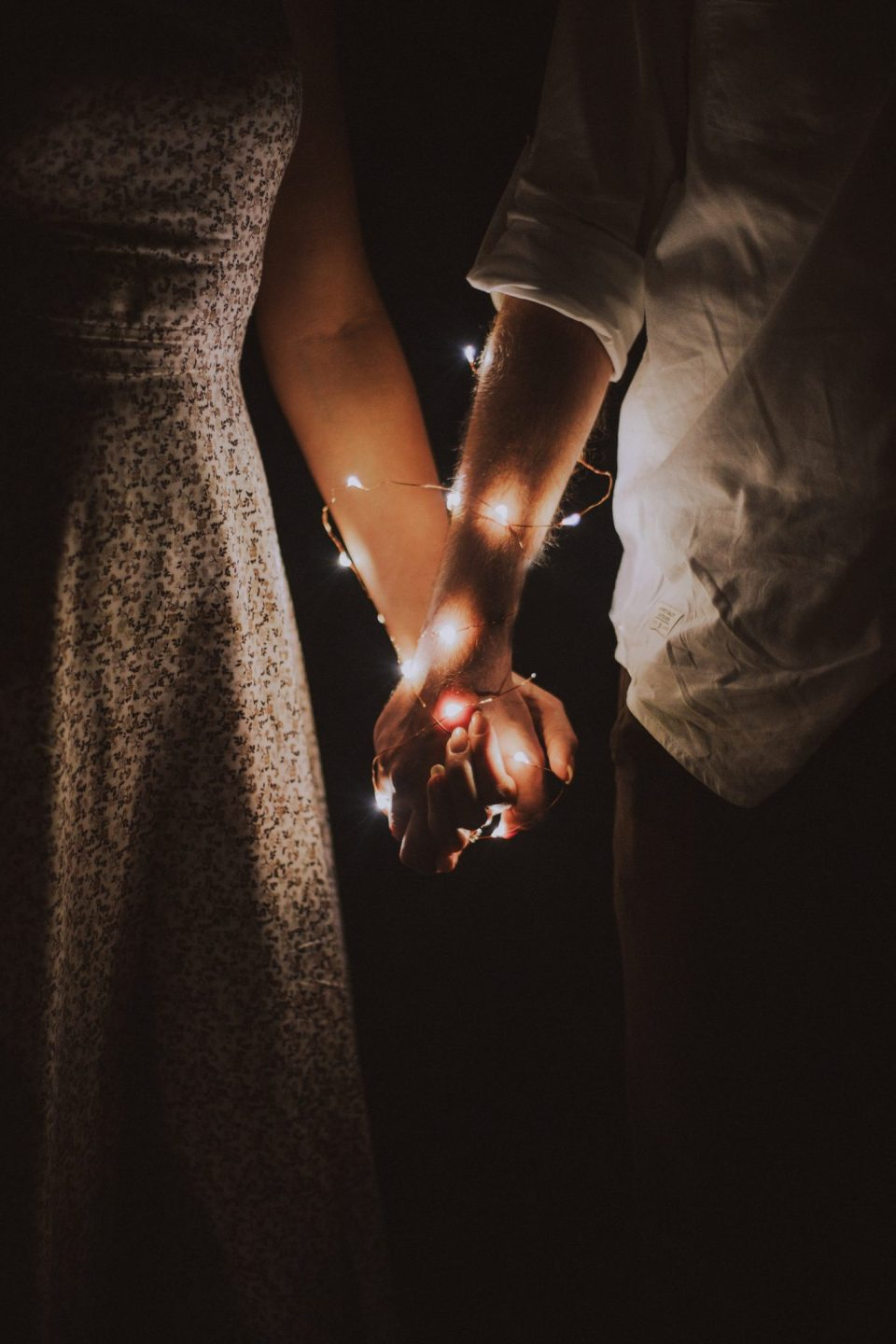 Image of a couple in love and holding hands