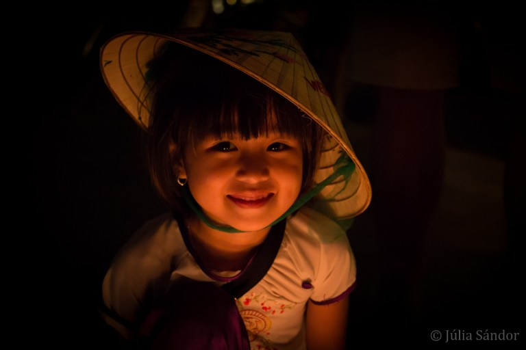 Vietnamese girl in the light of candles