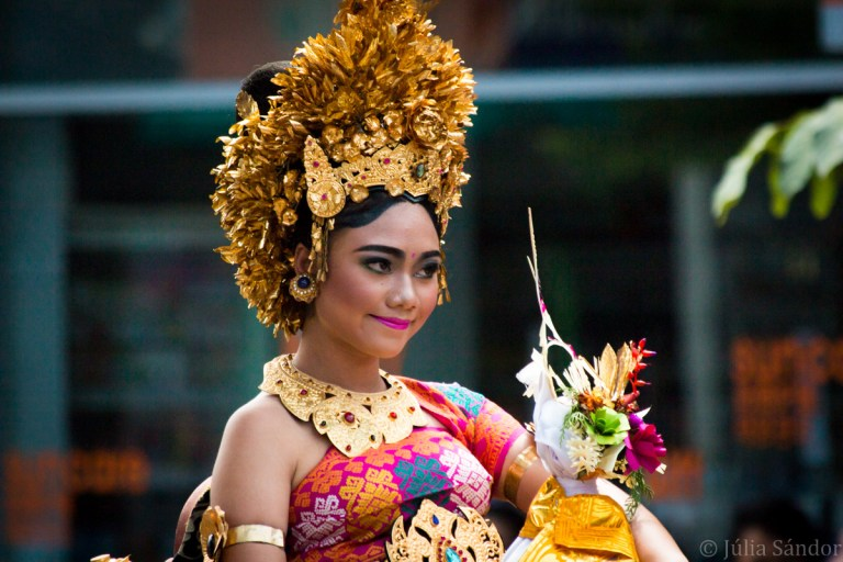 Balinese woman in traditional wear on a ceremony