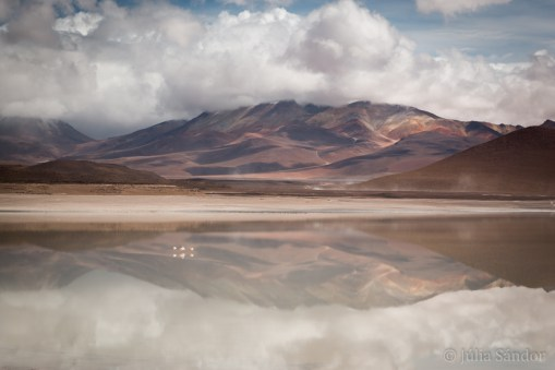 The White Lagoon (Laguna Blanca) is reflecting like a mirror.