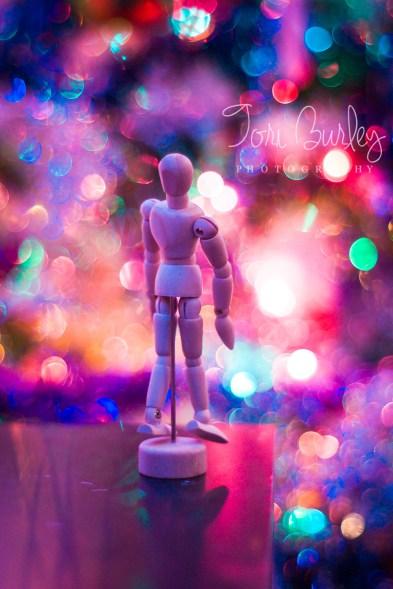 It's the edge of the world sketch man on the edge bokeh christmas lights