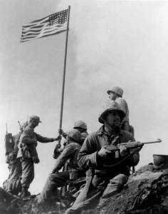 First flag raising at Iwo Jima.