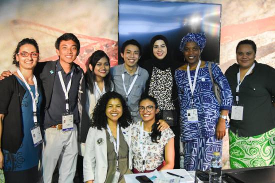 Happy young people at Ramsar COP13