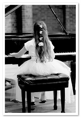 little girl playing piano at our NJ piano store