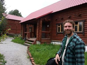 Outside the banya, relaxed and smiling