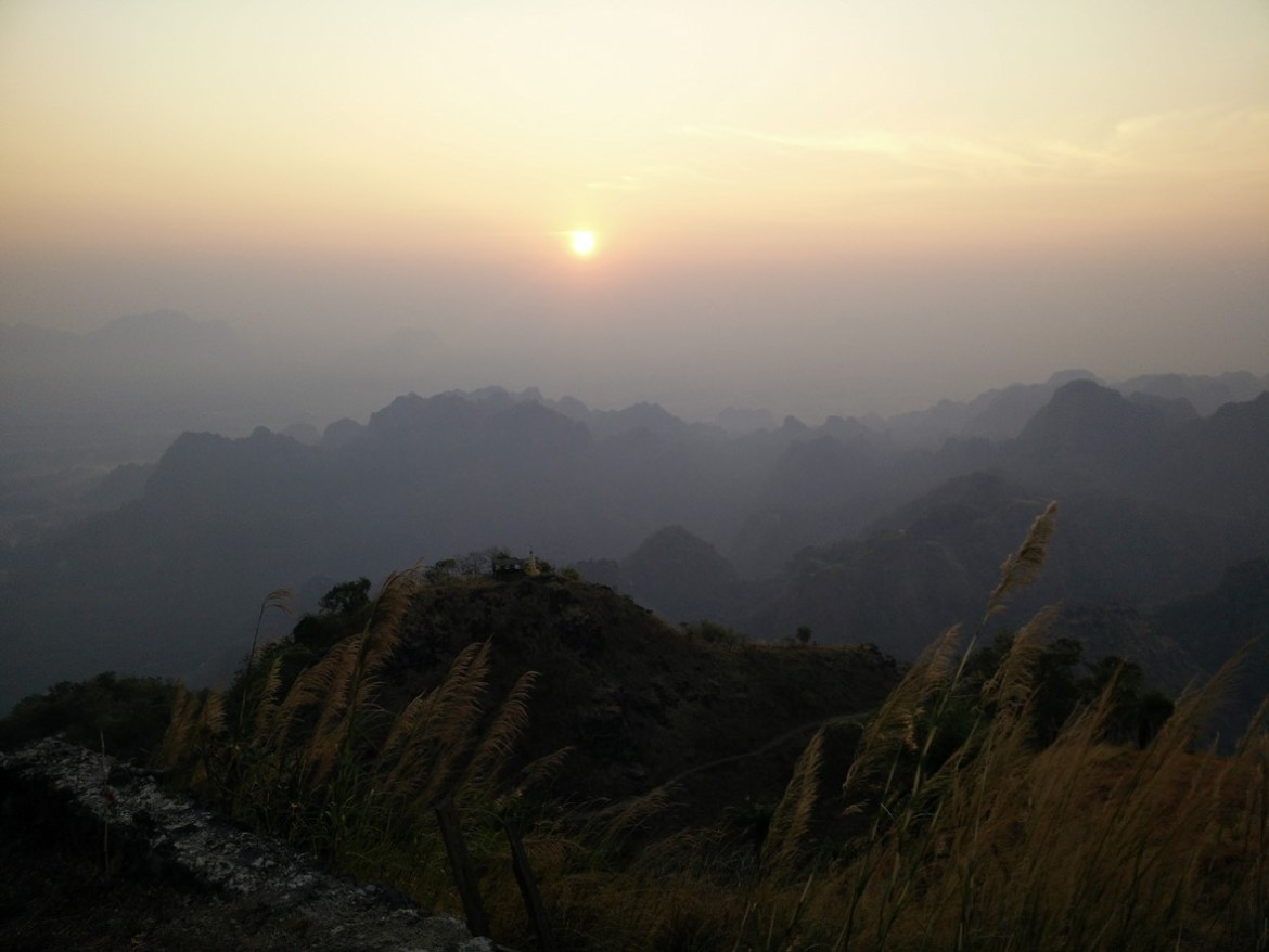 sunset at top of mt zwegabin in myanmar