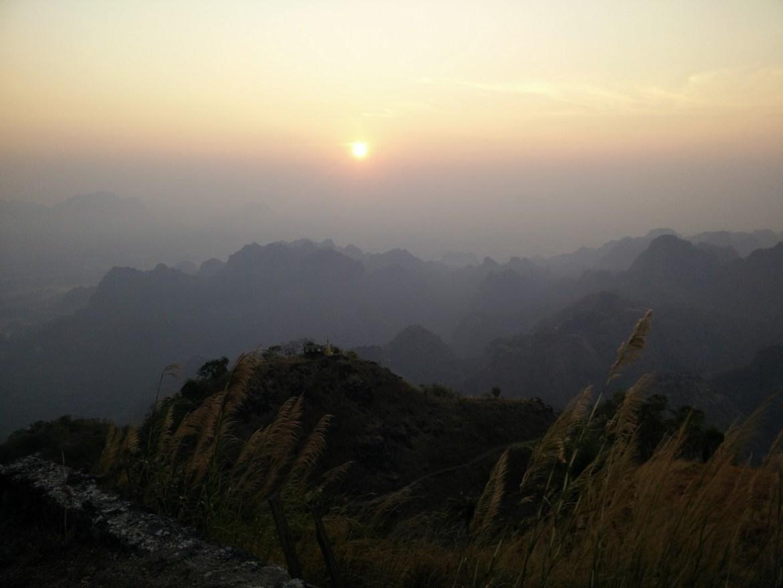 sunset at top of mt zwegabin in myanmar