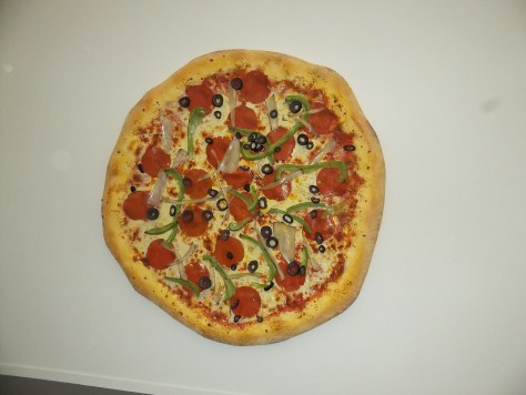 Pizza Sculpture on Wall
