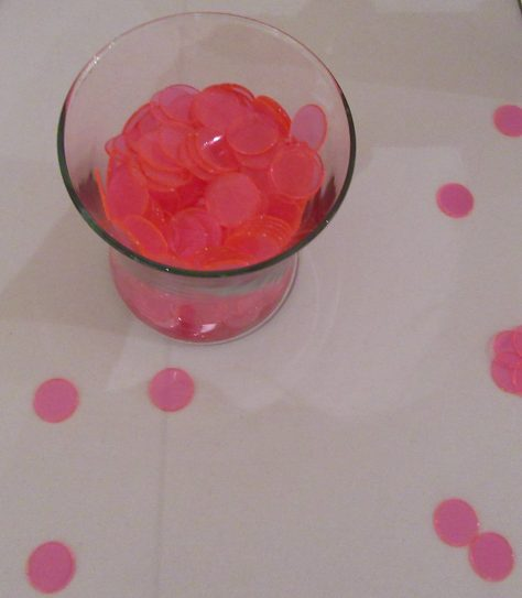 Glass of Pink Tiddly Winks