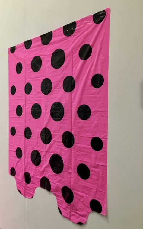 Pink Polka Dot Garbage Bag On The Wall