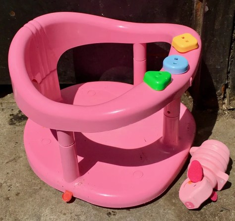 child seat and pig toy photo by gail worley