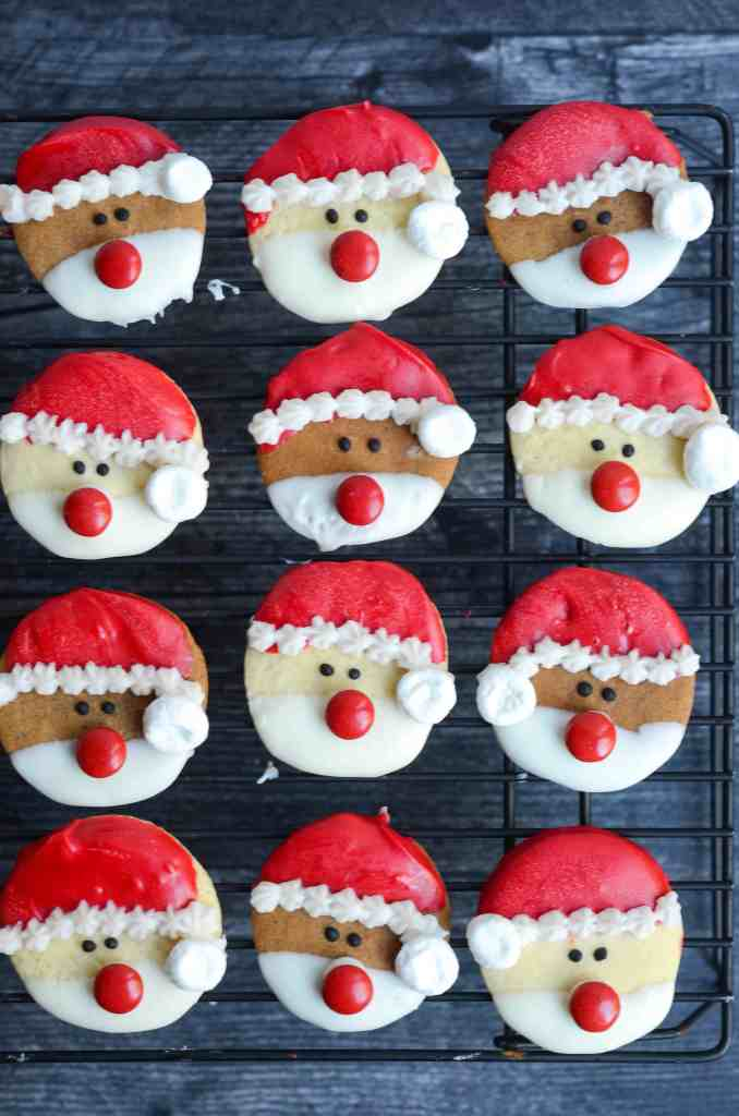santa cookies waiting to dry