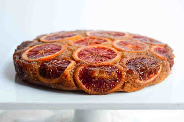 side view of uncut blood orange upside down cake