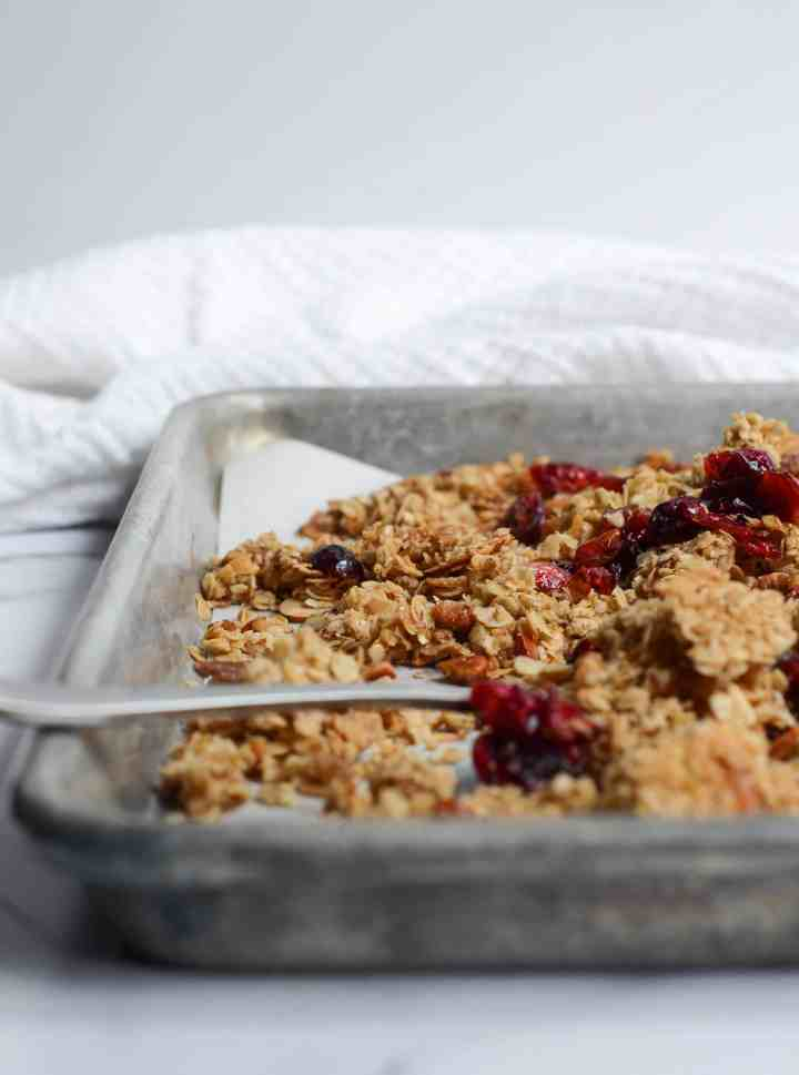 baked healthy homemade granola sitting to harden into clusters