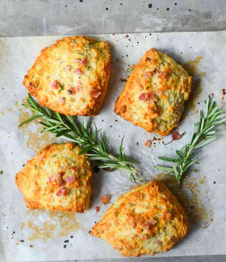 aerial shot of biscuits with two sprigs of rosemary
