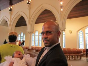 Father with child at baptism, St Andrew's United Reformed Church, Brockley, London UK -- by Ana Gobledale