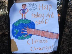 Demonstration poster -- climate change march, London 2015 -- photo by Ana Gobledale