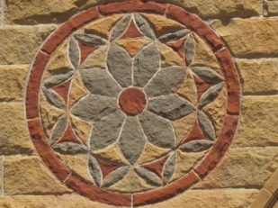 flower in stone art, Stanford University, California, USA -- photo by Ana Gobledale