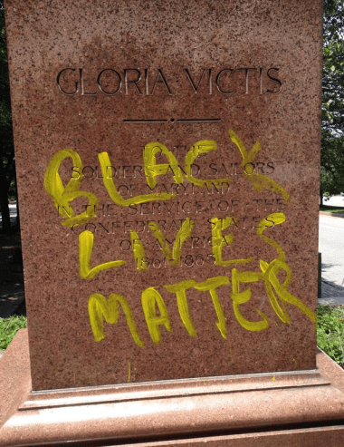 bal-black-lives-matter-spray-painted-on-confederate-statue-in-baltimore-20150622
