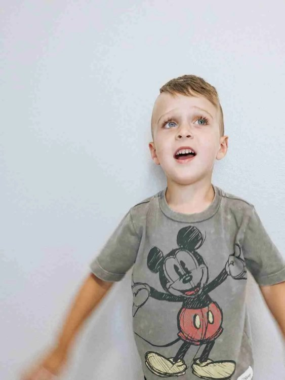 Little boy singing Disney songs and getting excited for family trips to Disneyland