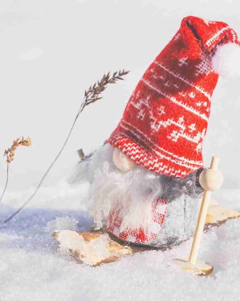 Little Christmas gnome on snow