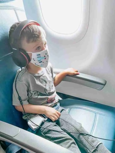 Toddler wearing a mask on a plane