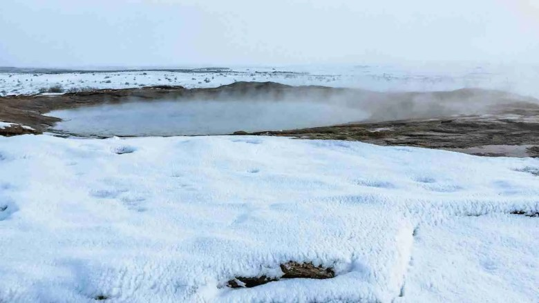 hot spring in Iceland surrounded by snow